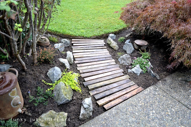 upcycling pallets is an inventive way to create a garden path and these are totally free get the tutorial at funky junk interiors