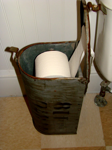 Repurposed mailbox for toilet paper storage