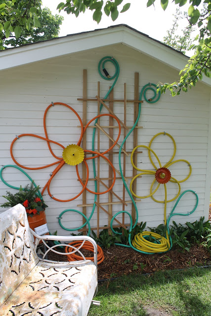 Garden Hose and Bundt Pans Turned into Flowers