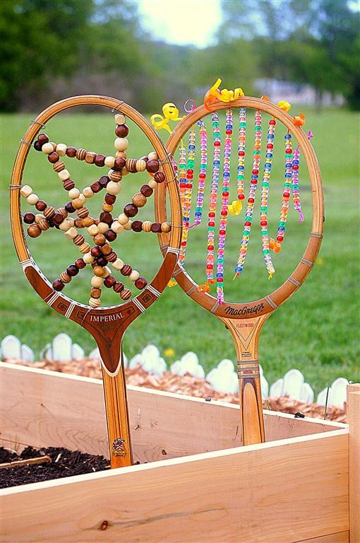 Garden Art Ideas junk garden art spoon reuse wall hook petunia glass jars Tennis Racket Garden Art