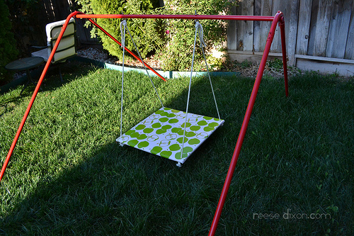 Adorable Wooden Swing Covered with Fabric