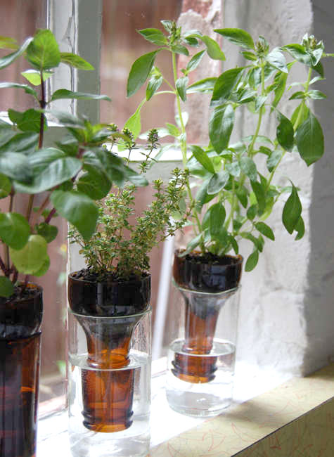 Recycled glass self-watering planter