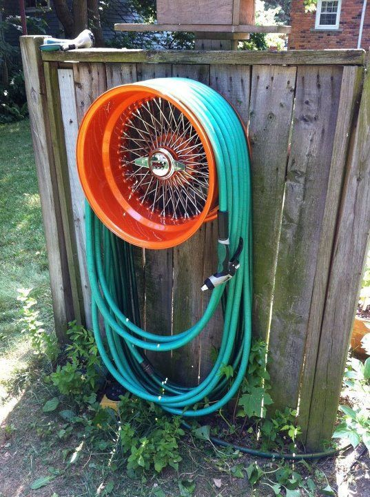 Garden Hose Storage Ideas industrial grade garden hose reel cart Upcycle Tire Rim To Garden Hose Holder Beautiful And Functional Found On Roadkill Customs