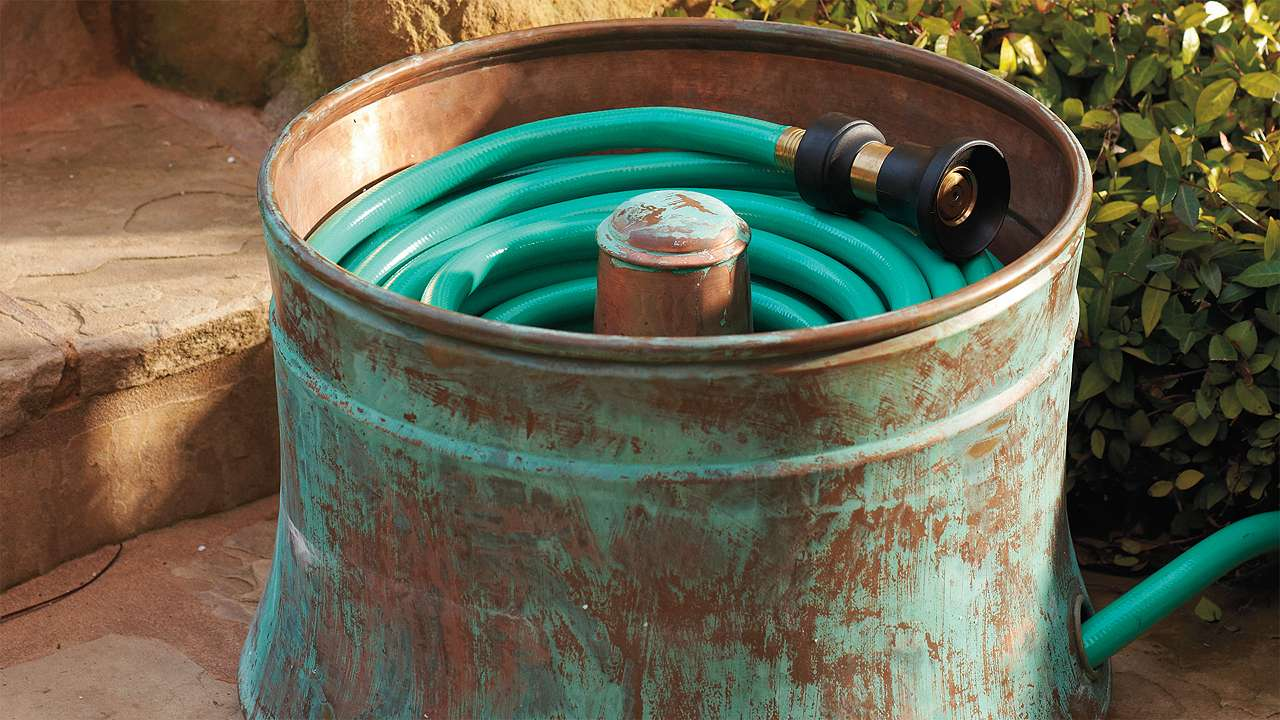 Use an Old Washing Machine Tub to Hold Your Garden Hose