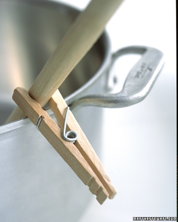 Clip a wooden clothespin to the spoon handle to keep the utensil from sliding into the pot