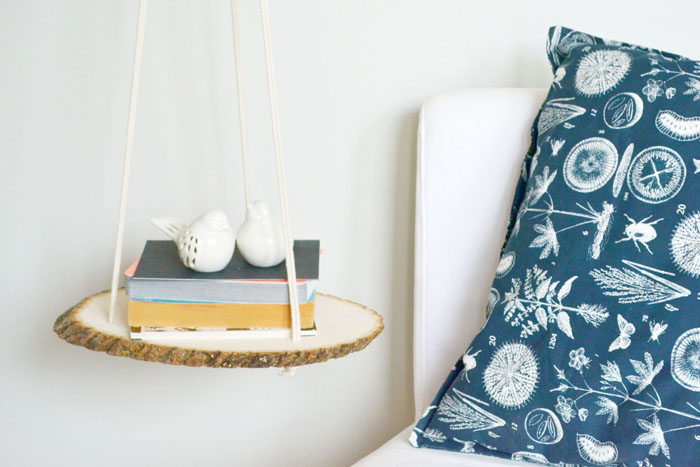 Nightstand suspended from the ceiling