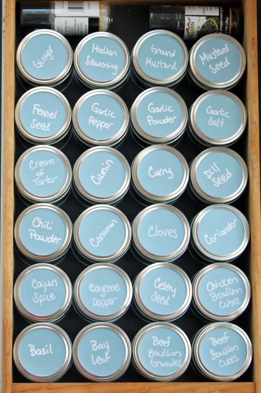 Organize your spices with mason jars and chalkboard paper